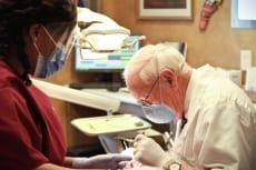Image: Dr. Wallace Lail working on patient - Lail Family Dentistry, Duluth GA