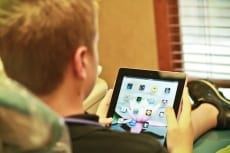 Image: Child works on iPad - Pediatric Dentistry at Lail Family Dentistry in Duluth, Georgia