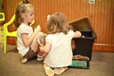 Image: Children play as they wait for dental care - Pediatric Dentistry at Lail Family Dentistry in Duluth, Georgia