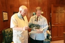 Image: Dr Slade and Dr. Wallace look at x-rays | Patient Resources - Lail Family Dentistry, Duluth GA